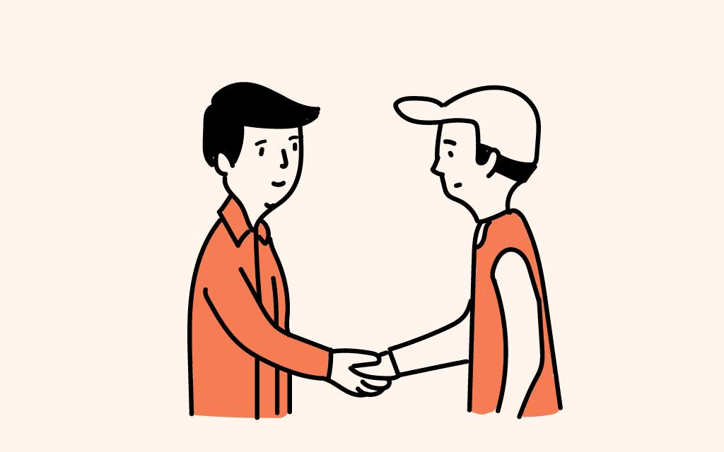 Hombre dándole la mano a un mecánico en agradecimiento por el balanceo de las llantas para su vehículo