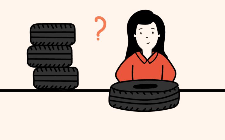 Mujer comprando llantas nuevas y preguntándose: ¿Dónde se deben ubicar un par de llantas nuevas?