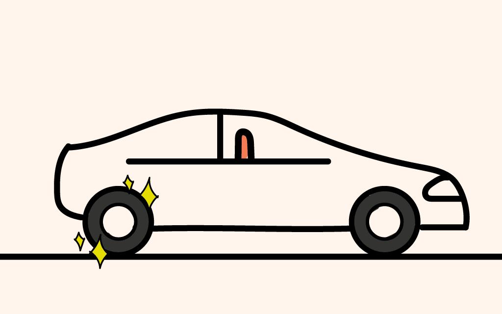 Automóvil con 2 llantas nuevas instaladas en el eje trasero